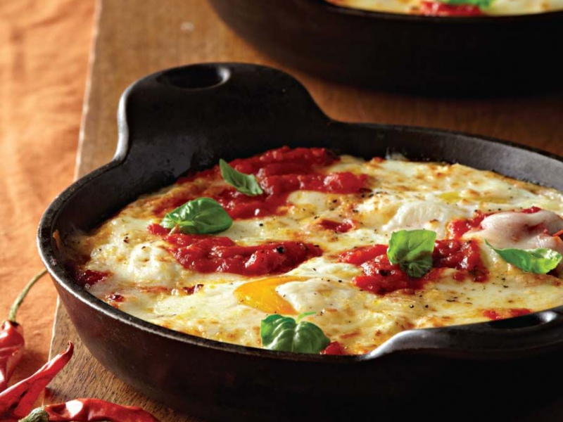 Baked Eggs with Ricotta, Mozzarella, and Spicy Tomato Sauce - Galbani Cheese